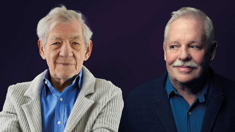 A deep purple backdrop with an image of Ian McKellan wearing a blue shirt and cream corduroy blazer on the left, and Armistead Maupin wearing a blue shirt and navy coloured blazer on the right