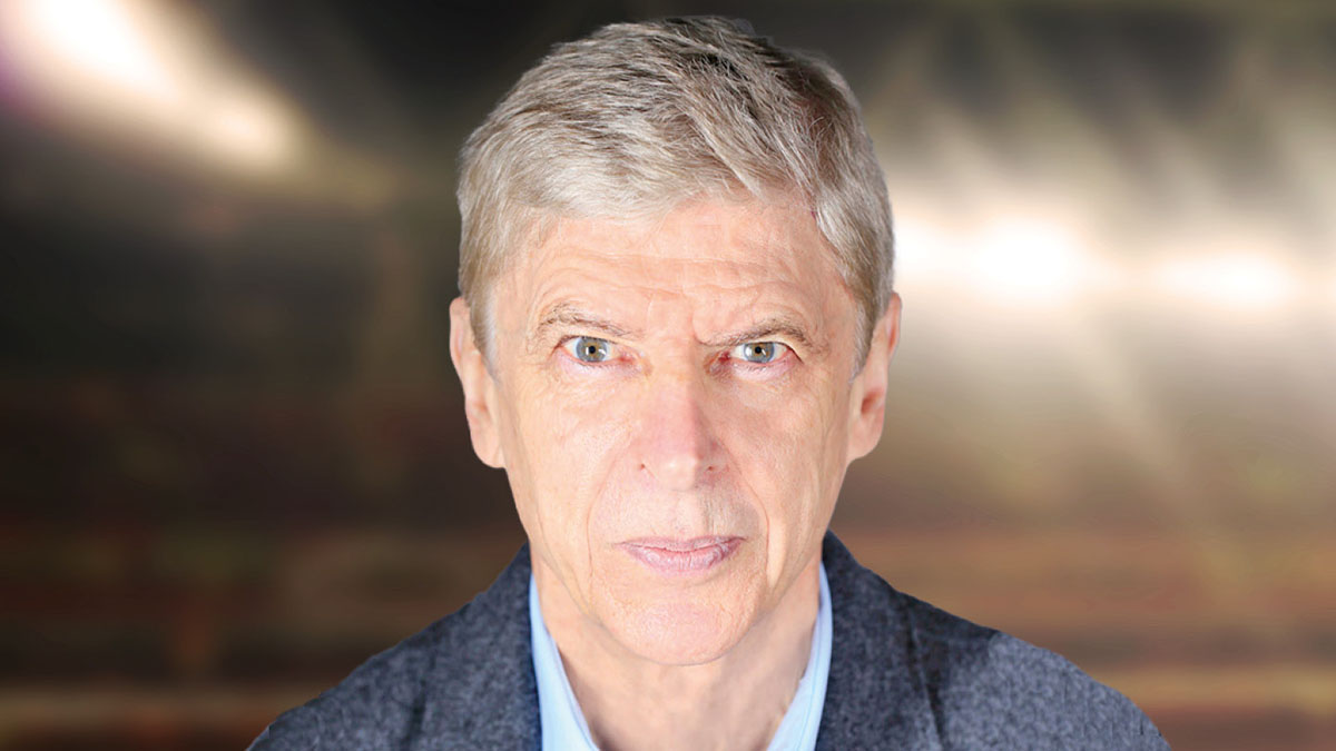 A headshot photo of Arsene Wenger against the backdrop of an out-of-focus football stadium